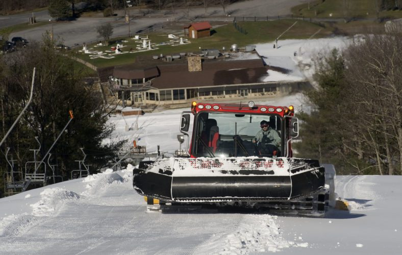 Ryan Locher, mountain manager at Bryce Resort, uses a Snowcat to groom the slopes at the resort on Tuesday afternoon. The resort plans to open the slopes today to start the ski season.  Rich Cooley/Daily